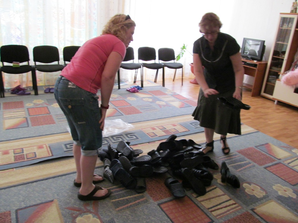 ira-and-jackie-helping-with-slippers-for-boys