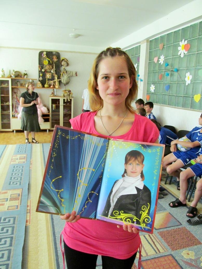 olya-kotova-with-graduation-album-a-gift-from-dniprokids